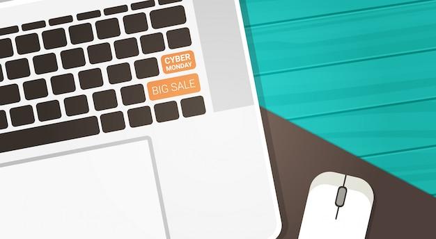 Botão de venda grande cyber segunda-feira no teclado do computador e mouse no fundo de madeira, conceito de desconto de compras de tecnologia