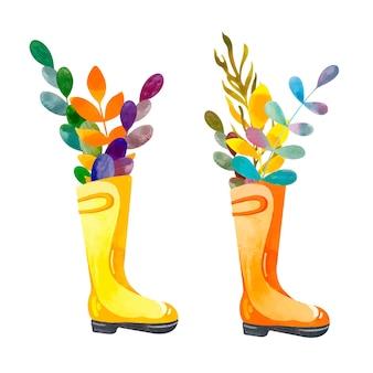 Botas de borracha amarela com folhas coloridas de outono