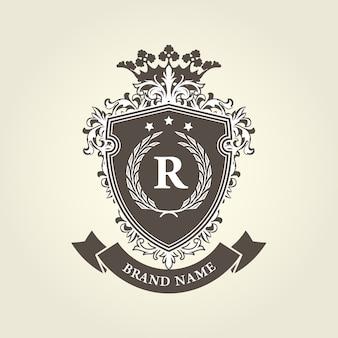 Brasão de armas real medieval - escudo com coroa e coroa de louros