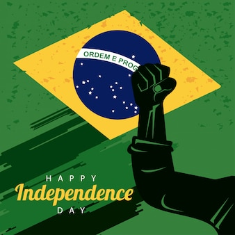 Brasil feliz celebração do dia da independência com bandeira e punho de mão