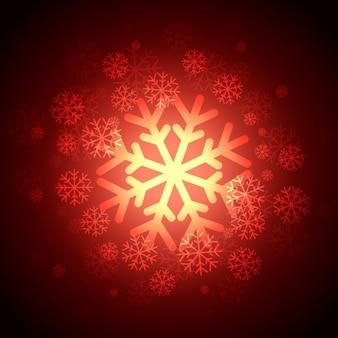 Brilhante flocos de neve fundo vermelho