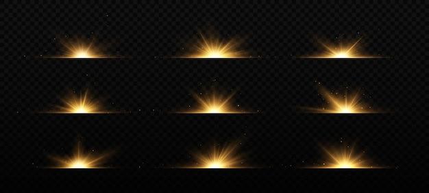 Brilhantes flashes dourados sobre fundo preto brilhando estrelas lindos raios dourados flares ópticos