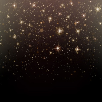 Brilho de partículas de ouro brilhante brilho mágico e fundo escuro de pó de estrela.