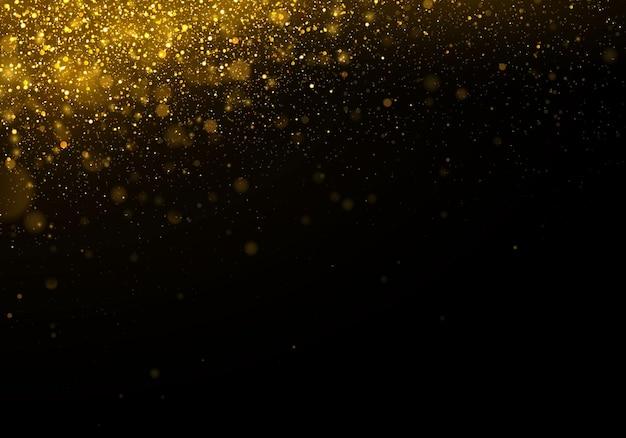 Brilho de textura e elegante para o natal partículas de pó amarelo mágico espumante ouro conceito mágico dourado fundo preto abstrato com efeito bokeh