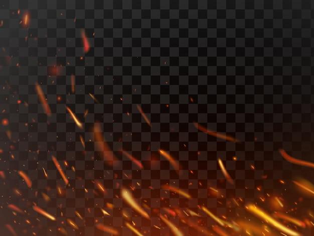 Brilhos de fogo quente close-up e partículas de chama isolado faísca
