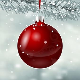 Brinquedo vermelho do natal no fundo da queda de neve.