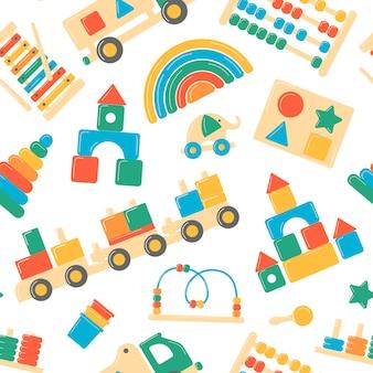 Brinquedos de madeira para crianças. padrão sem emenda em um fundo transparente.