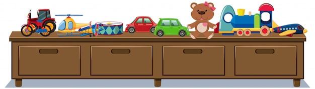 Brinquedos diferentes em gavetas de madeira