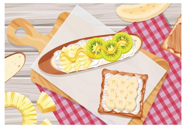Bruschetta com cobertura de kiwi e banana no fundo da mesa