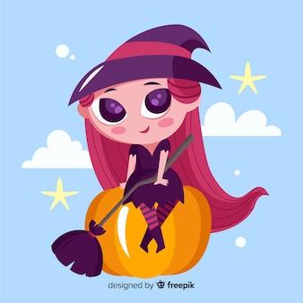 Bruxa de halloween bonito com abóbora