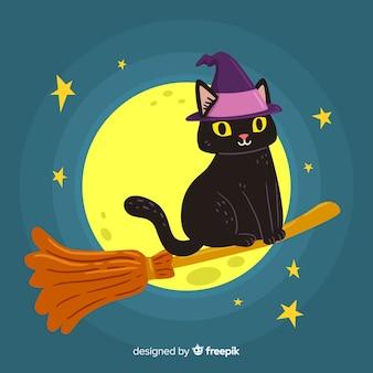 Bruxa gato e vassoura na lua cheia