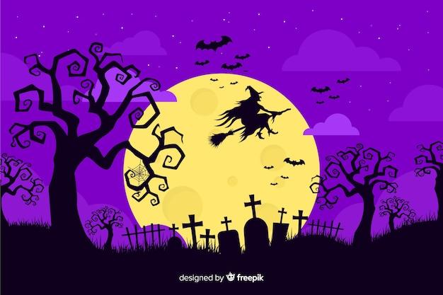 Bruxa na vassoura em uma noite de lua cheia