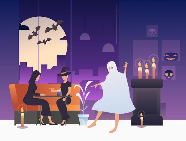 Bruxas bebendo cocktails enquanto fantasma dançando no bar