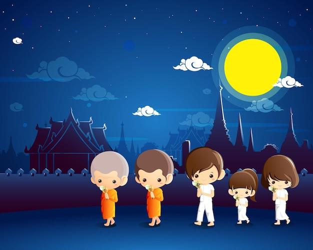 Budistas andando com velas acesas nas mãos ao redor de um templo para prestar homenagem