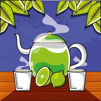Bule e xícaras de chá com limão