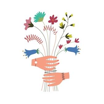 Buquê de flores silvestres coloridas nas mãos