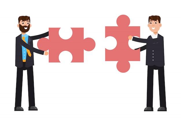 Businessmans segurando o quebra-cabeça. conceito de trabalho em equipe.