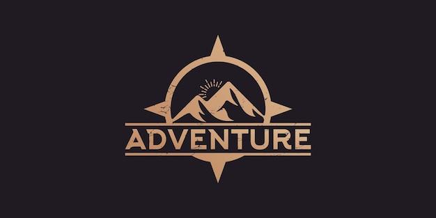 Bússola e logotipo vintage de aventura na montanha