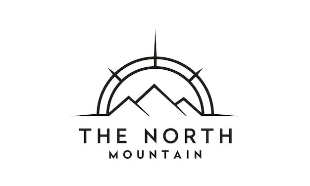 Bússola e montanha para viagem / aventura design de logotipo