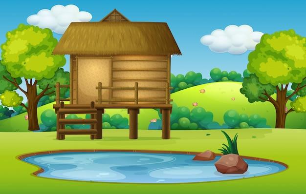 Cabana na cena da natureza da lagoa