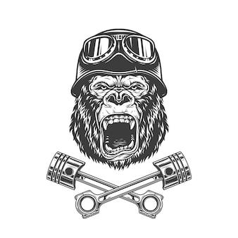Cabeça de gorila feroz no capacete de motoqueiro