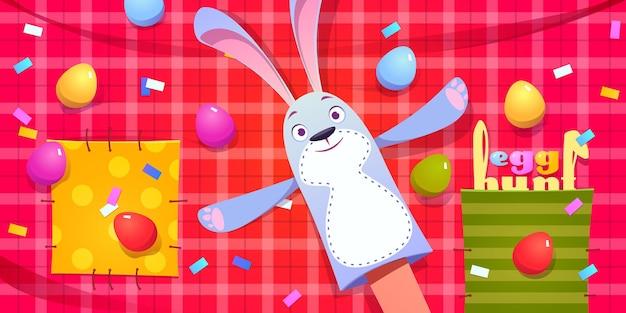 Caça ao ovo e celebração da páscoa com fantoche de coelho