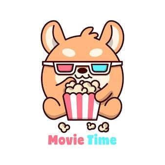 Cachorro brown bonito está usando óculos 3d enquanto come pop milho, logotipo mascote