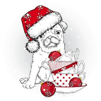 Cachorro lindo com chapéu e xícaras de natal