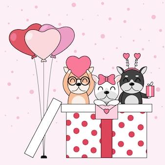 Cachorros bonitos com caixa de presente, cartão e os balões de coração.