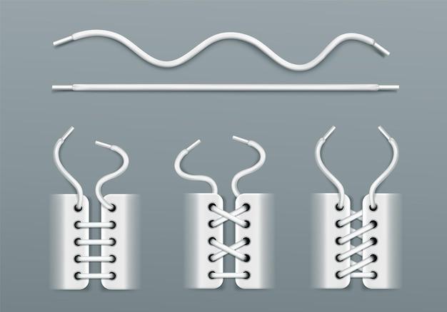 Cadarços brancos, amarrados por cordas nos tênis de maneiras diferentes.