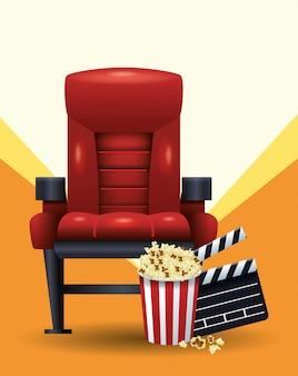 Cadeira de cinema com balde de pipoca e ripa sobre laranja e branco
