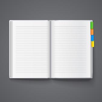 Caderno aberto para registros com abas coloridas.