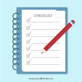 Caderno azul com lista de verificação e lápis vermelho