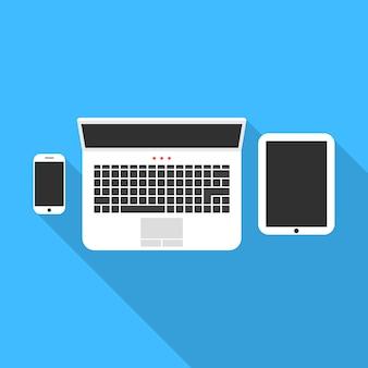 Caderno de telefone e tablet com sombra longa
