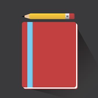 Caderno e lápis com sombra longa