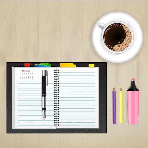 Caderno e papelaria no conceito de design criativo de mesa.