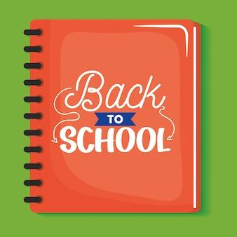 Caderno escolar com mensagem de volta às aulas