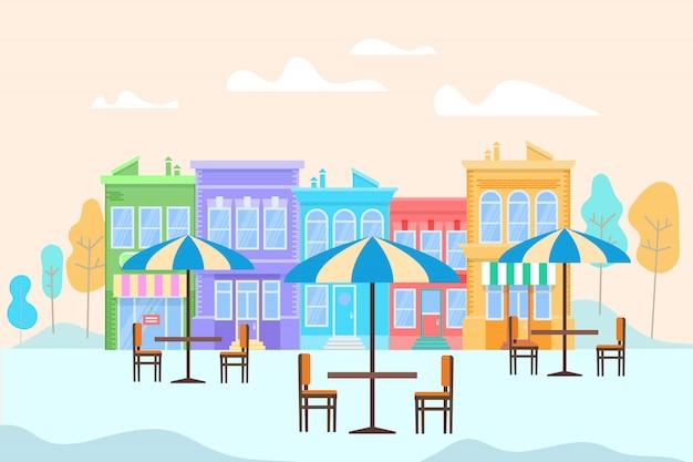 Café ao ar livre de verão com mesas e ubbrellas