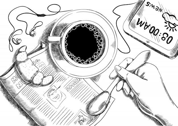 Café da manhã e jornal com croissant