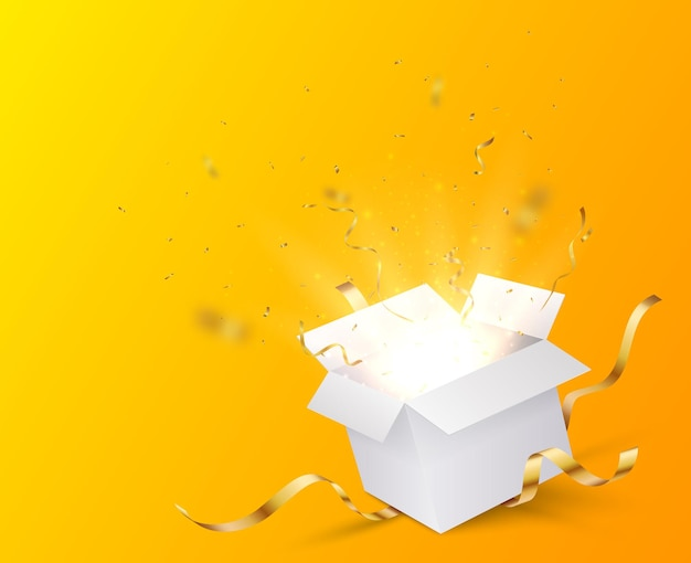 Caixa aberta com confete dourado e vermelho isolado