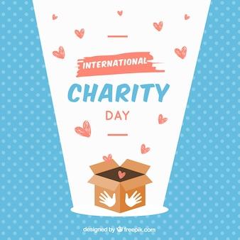 Caixa, corações e dia internacional da caridade