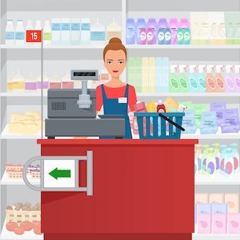 Caixa da mulher de saleslady que está na verificação geral no supermercado.