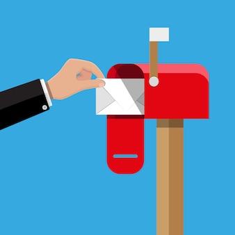 Caixa de correio aberta vermelha com correio normal dentro.
