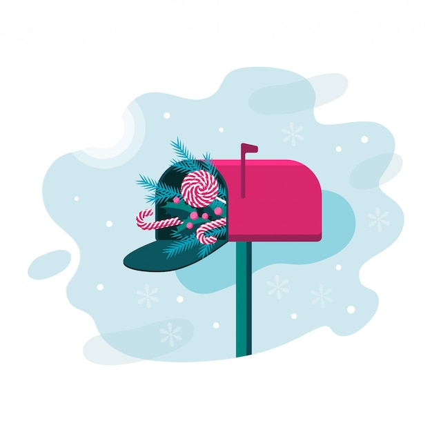 Caixa de correio de natal com pirulito de redemoinho, doces, ramos de pinheiro