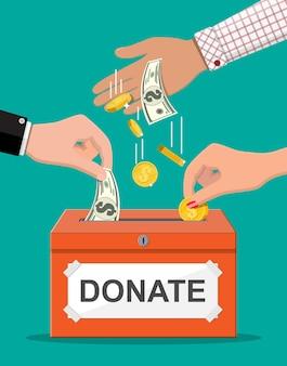 Caixa de doação com moedas de ouro e notas de dólar