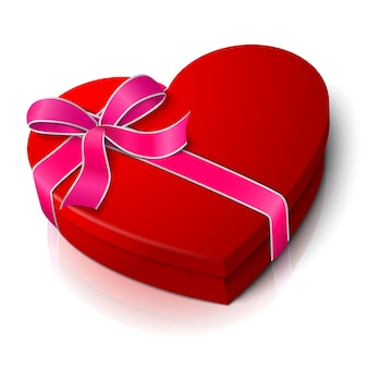 Caixa de forma de coração vermelho brilhante em branco realista com fita rosa e branca e laço isolado no fundo branco com reflexão. para o seu dia dos namorados ou amor apresenta design.