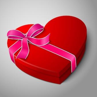 Caixa de formato de coração vermelho brilhante em branco realista de vetor com fita rosa e branca e laço isolado