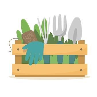 Caixa de jardim com ferramentas e mudas.