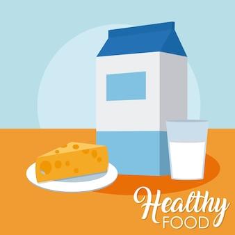Caixa de leite e copo com queijo