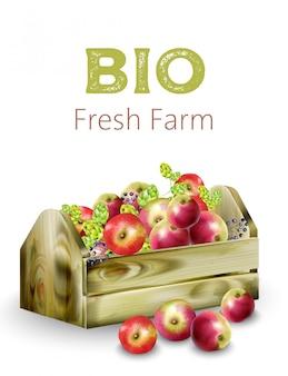 Caixa de madeira de fazenda fresca bio cheia de maçãs, alcachofras e frutas